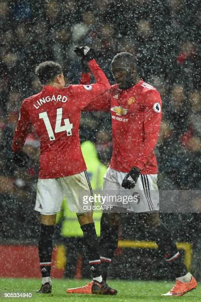 Manchester United's Belgian striker Romelu Lukaku celebrates with Manchester United's English midfielder Jesse Lingard after scoring their third goal...