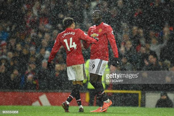 Manchester United's Belgian striker Romelu Lukaku celebrates with Manchester United's English midfielder Jesse Lingard after scoring their third goal...
