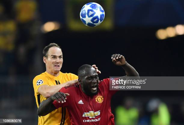 Manchester United's Belgian striker Romelu Lukaku fights for the ball with Young Boys Swiss defender Steve von Bergen during the UEFA Champions...