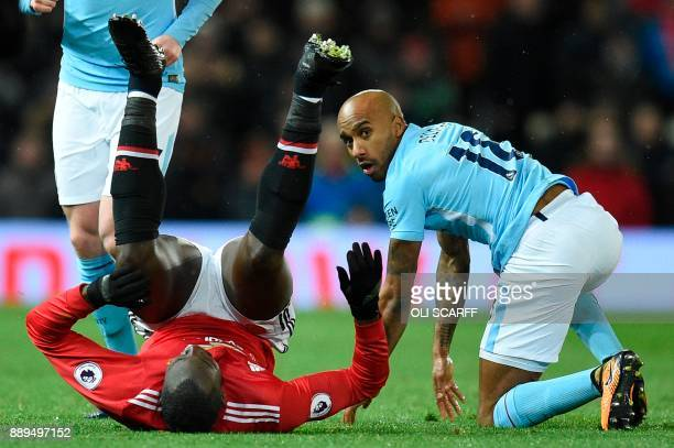 Manchester United's Belgian striker Romelu Lukaku goes down after a challenge with Manchester City's English midfielder Fabian Delph during the...