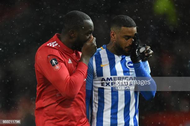 Manchester United's Belgian striker Romelu Lukaku greets Brighton's Dutch striker Jurgen Locadia after the final whistle during the English FA Cup...