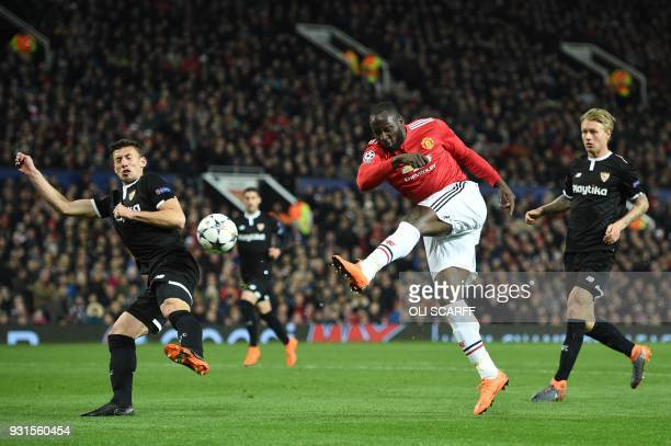 Manchester United's Belgian striker Romelu Lukaku has a shot by Sevilla's French defender Clement Lenglet during a last 16 second leg UEFA Champions...