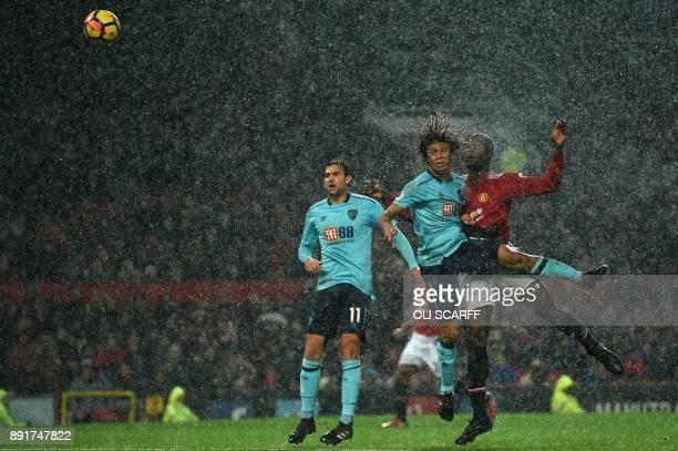 Manchester United's Belgian striker Romelu Lukaku heads the ball past Bournemouth's Dutch defender Nathan Ake to score during the English Premier...