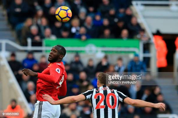 Manchester United's Belgian striker Romelu Lukaku heads the ball under pressure from Newcastle United's French midfiielder Florian Lejeune during the...
