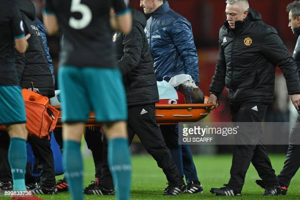 Manchester United's Belgian striker Romelu Lukaku is taken off on a stretcher after appearing to pick up a head injury during the English Premier...