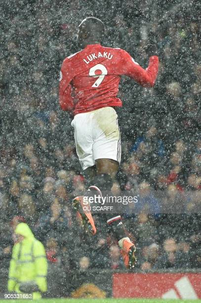 Manchester United's Belgian striker Romelu Lukaku jumps in celebration after scoring their third goal during the English Premier League football...