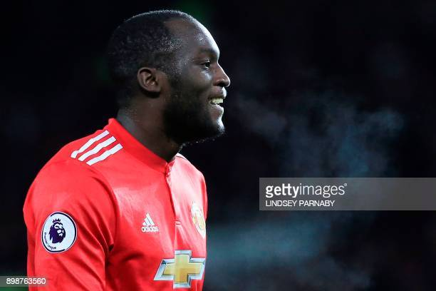 Manchester United's Belgian striker Romelu Lukaku reacts after missing a chance during the English Premier League football match between Manchester...