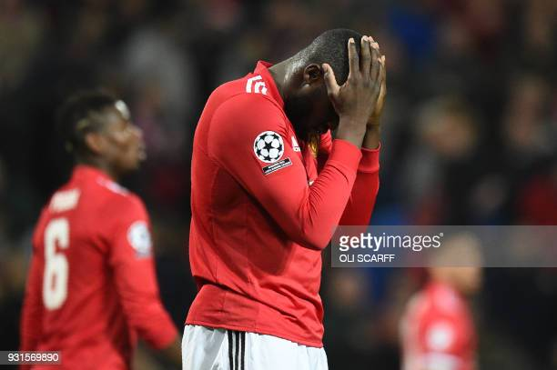TOPSHOT Manchester United's Belgian striker Romelu Lukaku reacts after missing a shot during a last 16 second leg UEFA Champions League football...