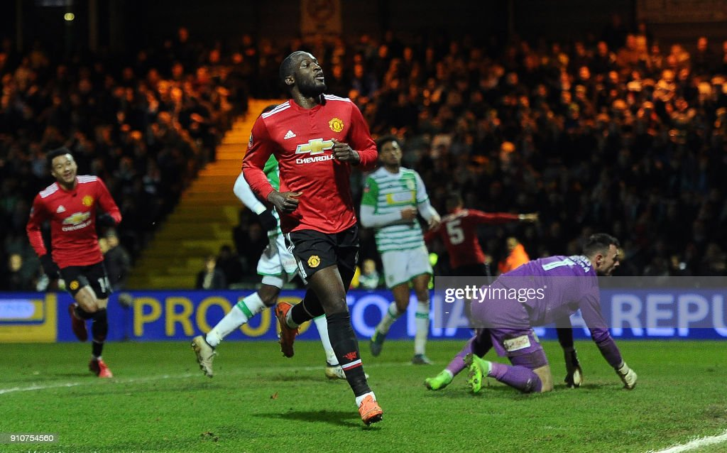 Manchester United's Belgian striker Romelu Lukaku (C) reacts after scoring their fourth goal during the FA Cup fourth round football match between Yeovil Town and Manchester United at Huish Park in Yeovil, Somerset on January 26, 2018. / AFP PHOTO / - / RESTRICTED TO EDITORIAL USE. No use with unauthorized audio, video, data, fixture lists, club/league logos or 'live' services. Online in-match use limited to 75 images, no video emulation. No use in betting, games or single club/league/player publications. /