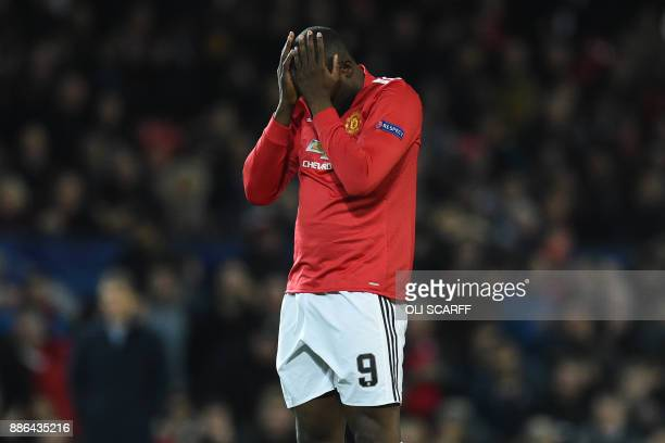 Manchester United's Belgian striker Romelu Lukaku reacts to an early miss from Rashford during the UEFA Champions League Group A football match...