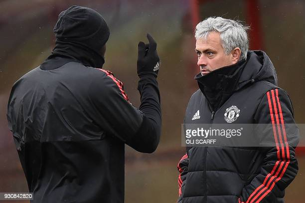 Manchester United's Belgian striker Romelu Lukaku talks with Manchester United's Portuguese manager Jose Mourinho during a team training session at...