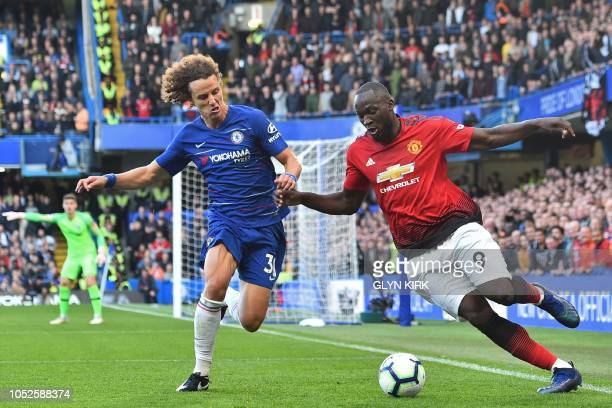 Manchester United's Belgian striker Romelu Lukaku vies with Chelsea's Brazilian defender David Luiz during the English Premier League football match...