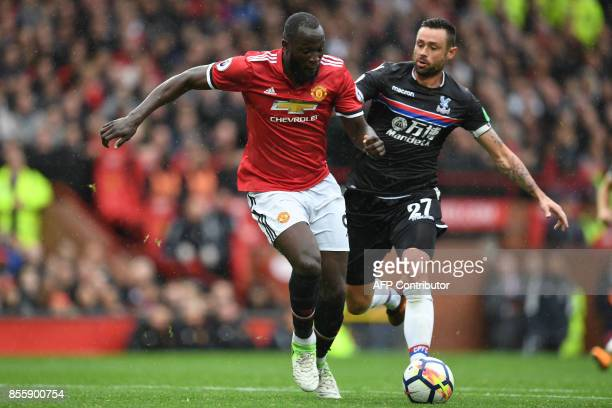 Manchester United's Belgian striker Romelu Lukaku vies with Crystal Palace's Irish defender Damien Delaney during the English Premier League football...