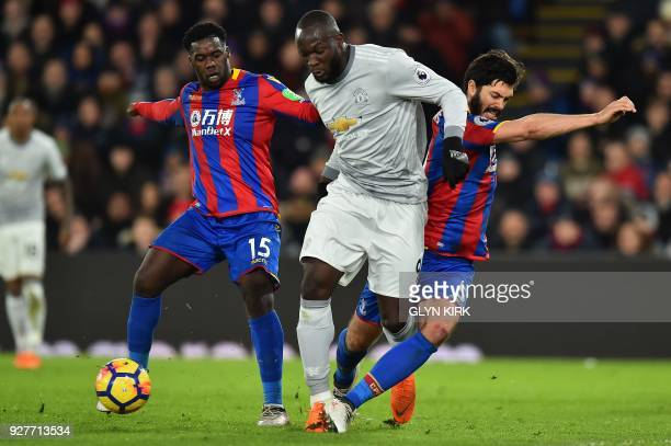 Manchester United's Belgian striker Romelu Lukaku vies with Crystal Palace's German midfielder Jeffrey Schlupp and Crystal Palace's English defender...