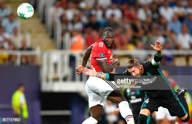 Manchester United's Belgian striker Romelu Lukaku vies with Real Madrid's Spanish defender Sergio Ramos during the UEFA Super Cup football match...