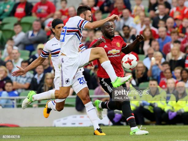 Manchester United's Belgian striker Romelu Lukaku vies with Sampdoria's Matias Silvestre and Sampdoria's Vasco Regini during the preseason friendly...