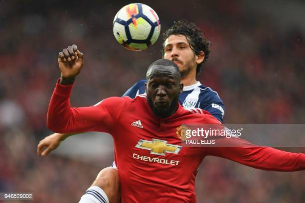 Manchester United's Belgian striker Romelu Lukaku vies with West Bromwich Albion's Egyptian defender Ahmed Hegazy during the English Premier League...