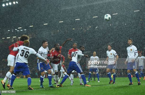 Manchester United's Belgian striker Romelu Lukaku watches the ball after heading to scores his team's second goal during the UEFA Champions League...
