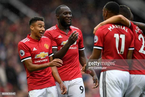Manchester United's Belgian striker Romelu Lukaku with teammates celebrates scoring the team's fourth goal during the English Premier League football...