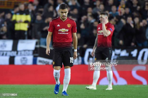 Manchester United's Belgianborn Brazilian midfielder Andreas Pereira reacts after Valencia scored a goal during the UEFA Champions League group H...