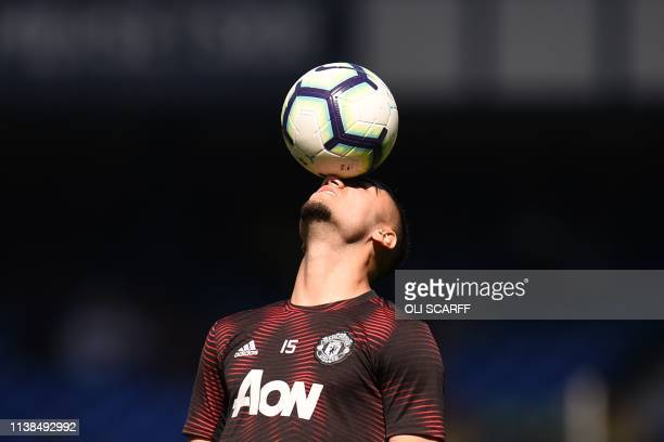 TOPSHOT Manchester United's Belgianborn Brazilian midfielder Andreas Pereira warms up before the English Premier League football match between...