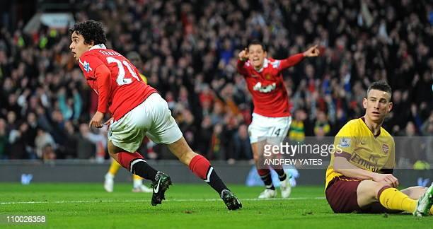 Manchester United's Brazilian defender Fabio Da Silva celebrates after scoring the opening goal as Arsenal's French defender Laurent Koscielny looks...