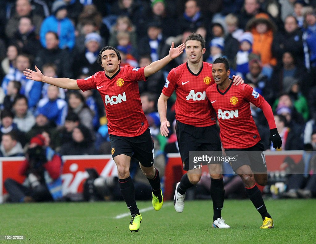 "Manchester United's Brazilian defender Rafael da Silva (L) celebrates scoring the opening goal with English midfielder Michael Carrick (2nd L) and Portuguese midfielder Nani (R) during the English Premier League football match between Queens Park Rangers and Manchester United at Loftus Road in London on February 23, 2013. USE. No use with unauthorized audio, video, data, fixture lists, club/league logos or ""live"" services. Online in-match use limited to 45 images, no video emulation. No use in betting, games or single club/league/player publications"