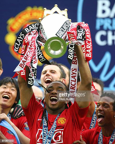 Manchester United's Brazilian midfielder Anderson holds the English Premier League trophy after Manchester United beat Wigan Athletic at The JJB...
