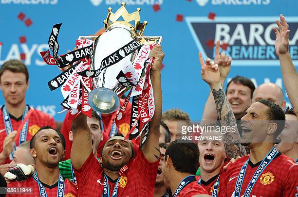 Manchester United's Brazilian midfielder Anderson lifts the Premier League trophy after the English Premier League football match between Manchester...