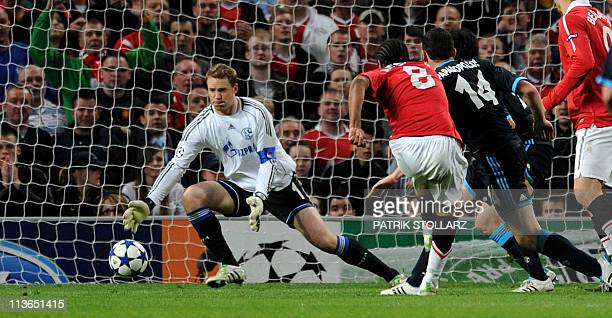 Manchester United's Brazilian midfielder Anderson scores during the UEFA Champions League semifinal second leg football match between Manchester...