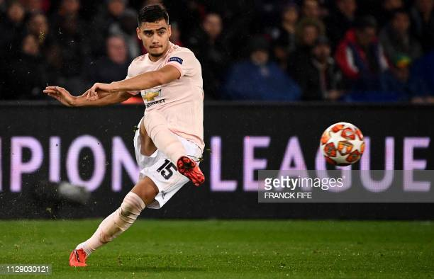 Manchester United's Brazilian midfielder Andreas Pereira plays a shot during the UEFA Champions League round of 16 secondleg football match between...