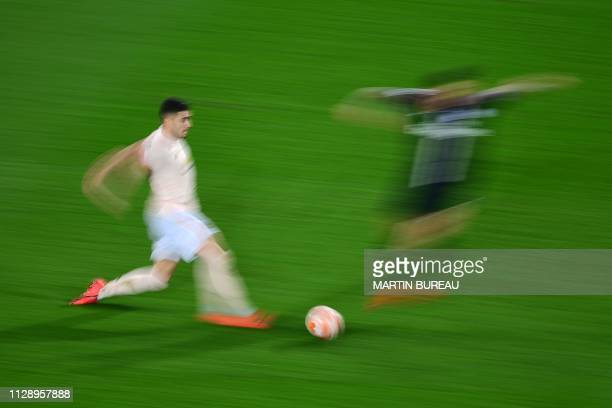 Manchester United's Brazilian midfielder Andreas Pereira runs with the ball during the UEFA Champions League round of 16 secondleg football match...