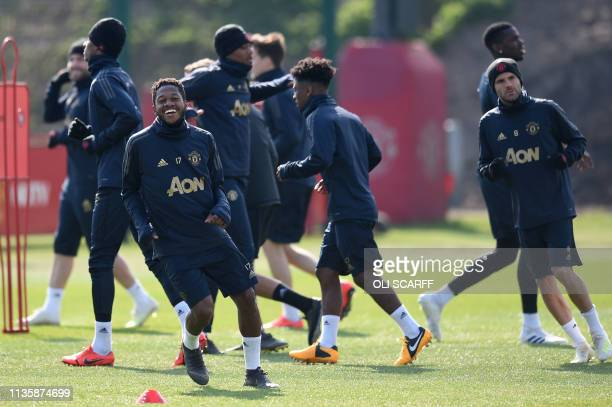 Manchester United's Brazilian midfielder Fred and teammates jog during a training session at the Carrington training ground in greater Manchester...
