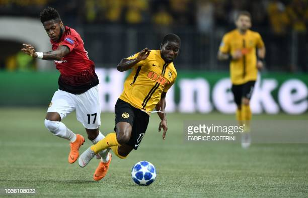Manchester United's Brazilian midfielder Fred and Young Boys Ivorian forward Roger Assalé fight for the ball during the UEFA Champions League group H...