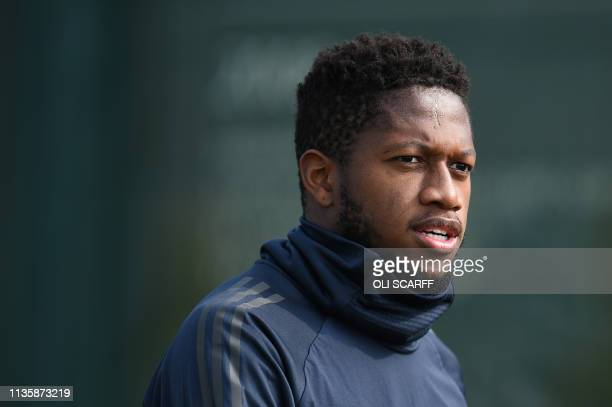 Manchester United's Brazilian midfielder Fred attends a training session at the Carrington training ground in greater Manchester, north west England...