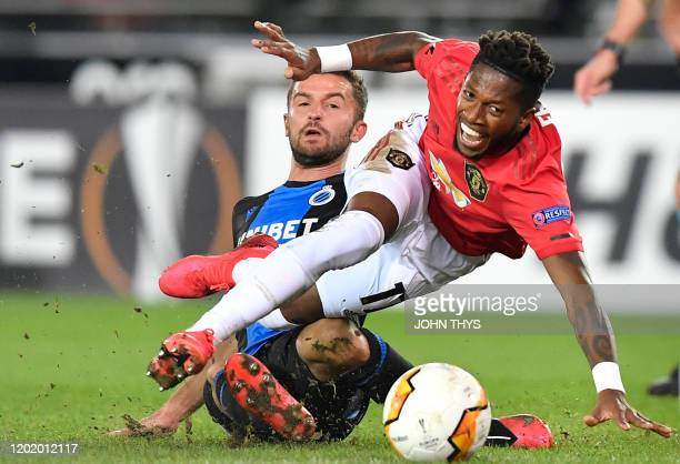 Manchester United's Brazilian midfielder Fred fights for the ball with Club Brugge's Belgian forward Siebe Schrijvers during the UEFA Europa League...