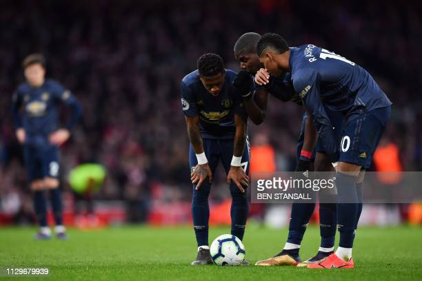 Manchester United's Brazilian midfielder Fred , Manchester United's French midfielder Paul Pogba and Manchester United's English forward Marcus...