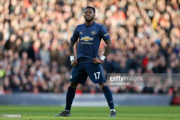 Manchester United's Brazilian midfielder Fred reacts after his shot hits the post during the English Premier League football match between Arsenal...