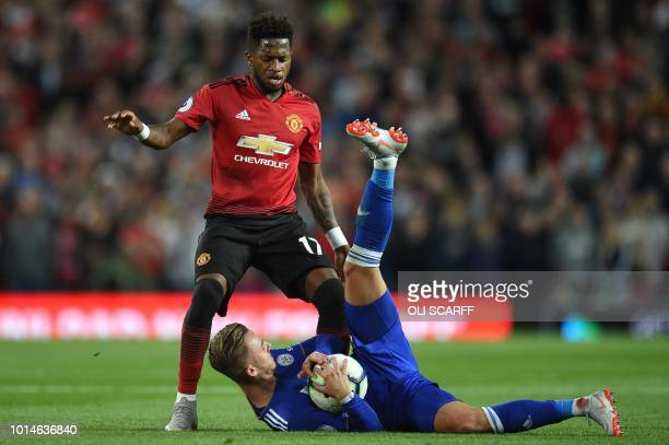 Manchester United's Brazilian midfielder Fred vies with Leicester City's English midfielder James Maddison during the English Premier League football...