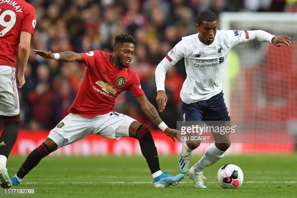 TOPSHOT Manchester United's Brazilian midfielder Fred vies with Liverpool's Dutch midfielder Georginio Wijnaldum during the English Premier League...
