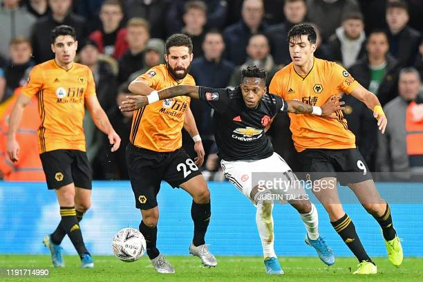 Manchester United's Brazilian midfielder Fred vies with Wolverhampton Wanderers' Portuguese midfielder Joao Moutinho and Wolverhampton Wanderers'...