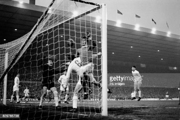 Manchester United's Brian Kidd heads the ball against the bar from close range