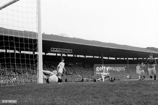 Manchester United's Brian Kidd looks on as a shot from teammate Pat Crerand beats Real Madrid goalkeeper Antonio Betancourt but hits the post