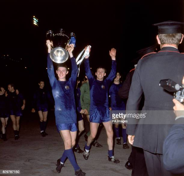 Manchester United's Brian Kidd shows off the European Cup after his team's 41 win as teammate Pat Crerand celebrates In the background are United's...