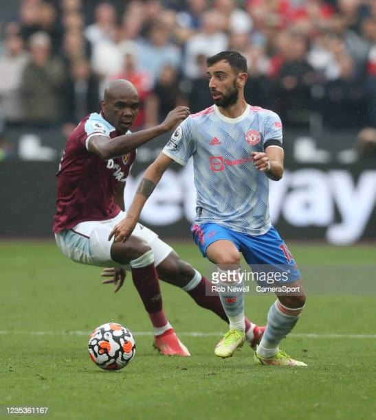 Manchester United's Bruno Fernandes and West Ham United's Angelo Ogbonna during the Premier League match between West Ham United and Manchester...
