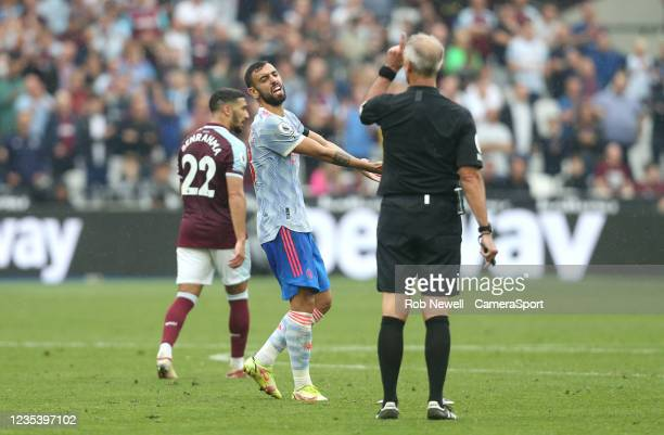 Manchester United's Bruno Fernandes appeals to referee Martin Atkinson during the Premier League match between West Ham United and Manchester United...