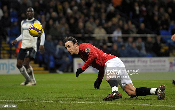 Manchester United's Bulgarian forward Dimitar Berbatov heads the opening goal during the English Premier league football match against Bolton...
