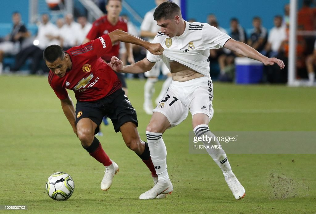 Manchester United's Chilean foward Alexis Sanchez (L) vies for the ball with Real Madrid's Uruguayan midfielder Federico Valverde (R) during their International Champions Cup friendly football match at Hard Rock Stadium in Miami, Florida, on July 31, 2018.