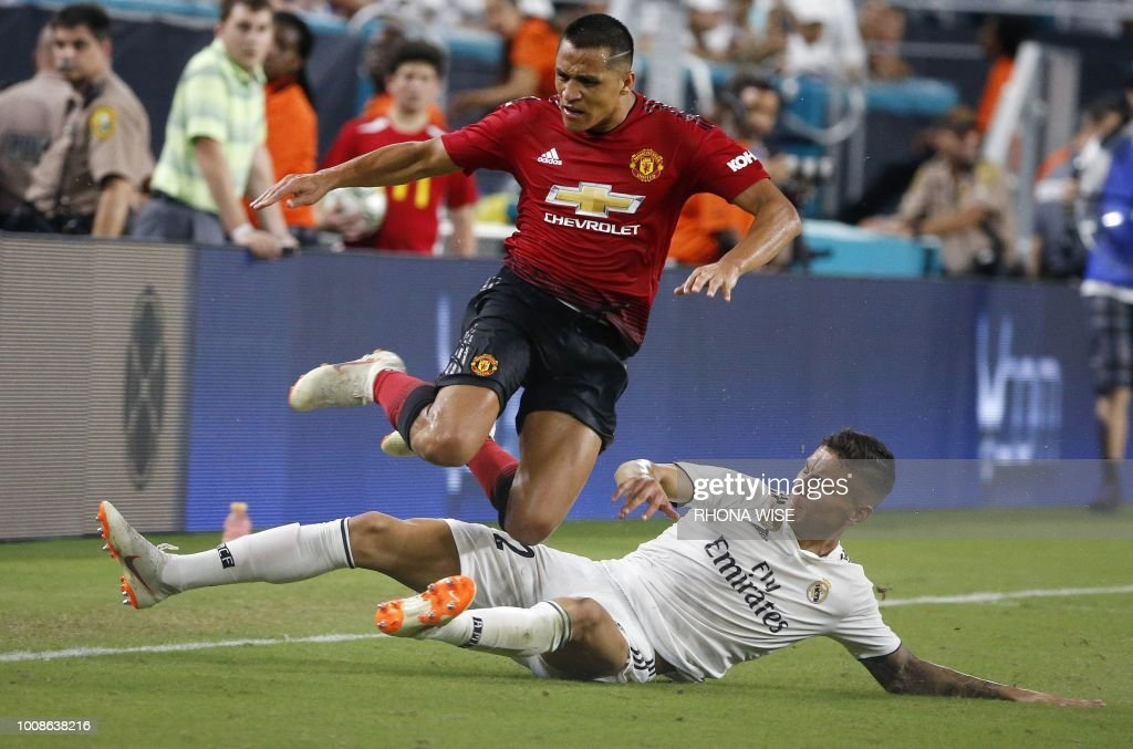 Manchester United's Chilean foward Alexis Sanchez (L) vies for the ball with Real Madrid's Spanish defender Javier Sanchez (R) during their International Champions Cup friendly football match at Hard Rock Stadium in Miami, Florida, on July 31, 2018.