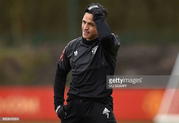 Manchester United's Chilean striker Alexis Sanchez attends a team training session at the club's training complex near Carrington, west of Manchester...